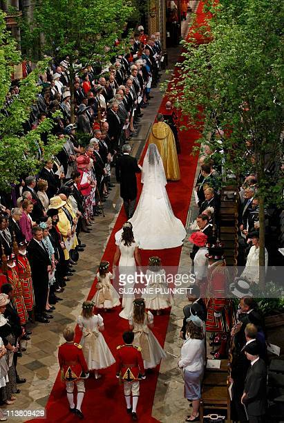 Kate Middleton arrives with her father Michael at Westminster Abbey followed by her sister and Maid of Honour Pippa Middleton prior to her royal...