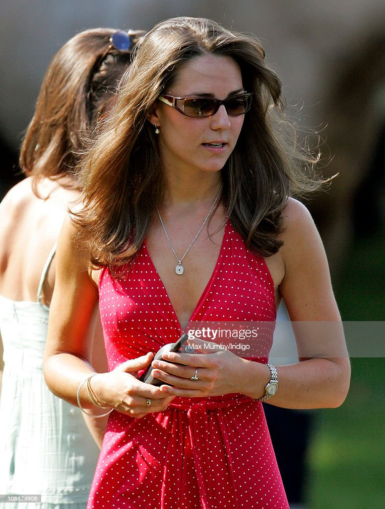 Kate Middleton carries a Police radio as she watches Prince William compete in the Chakravarty Cup charity polo match at Ham Polo Club on June 17, 2006 in Richmond, England.