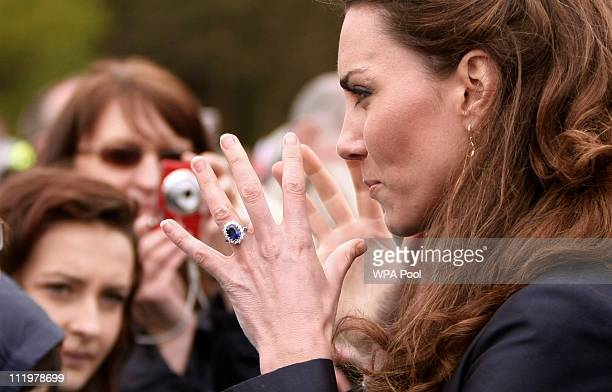 Kate Middleton fiancee of Britain's Prince William shakes hands with wellwishers following a visit with William to Darwen Aldridge Community Academy...