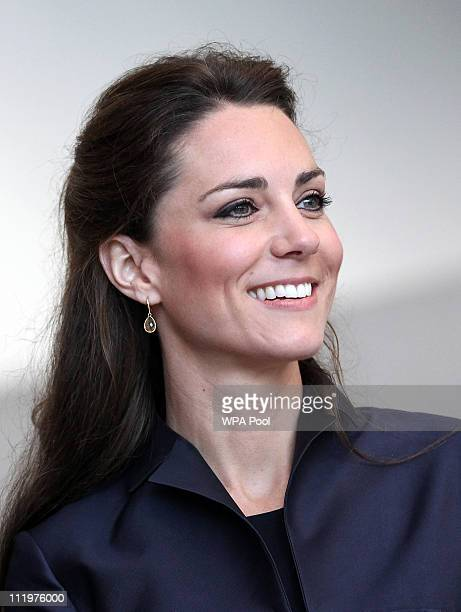 Kate Middleton fiancee of Britain's Prince William watches a demonstration by students during a visit with William to Darwen Aldridge Community...