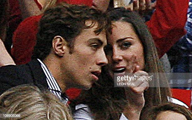 Kate Middleton former girlfriend of Prince William and an unknown friend chat as they watch a performance at Wembley stadium in north London 01 July...