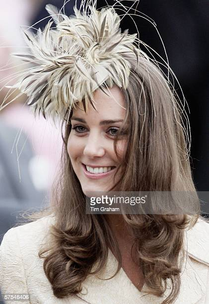 Kate Middleton girlfriend of Prince Willliam smiles at the marriage of Laura ParkerBowles and Harry Lopes at St CyriacOs Church Lacock on May 6 2006...