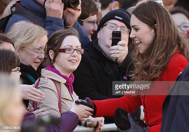Kate Middleton greets onlookers as she visits the University of St Andrews with Prince William on February 25 2011 in St Andrews Scotland The couple...