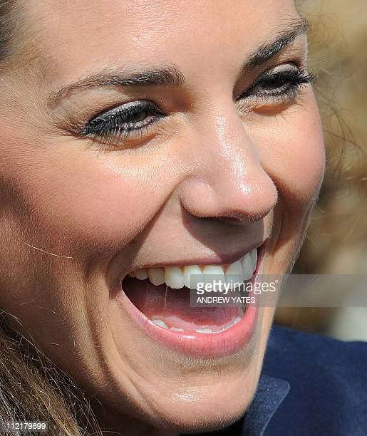 Kate Middleton laughs after a visit to Witton Country Park with her fiancee Britain's Prince William in Darwen Lancashire northwest England on April...