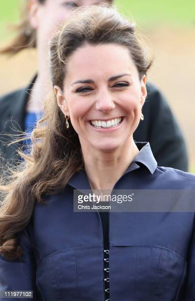 Kate Middleton laughs during a visit to Whitton Park on April 11 2011 in Darwen England With less than three weeks to go until the Royal Wedding...
