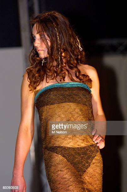Kate Middleton models on the catwalk at a student fashion show attended by Prince William, on March 2002 in St.Andrews, Scotland.