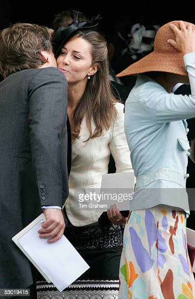 Kate Middleton Prince William's girlfriend kisses a guest at the society wedding of Hugh Van Cutsem Junior to Rose Astor at Burford Parish Church on...