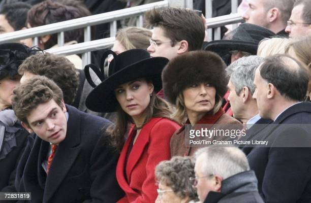 Kate Middleton, Prince William's girlfriend, sits with her parents Carole and Michael and Prince William's Private Secretary Jamie Lowther-Pinkerton...