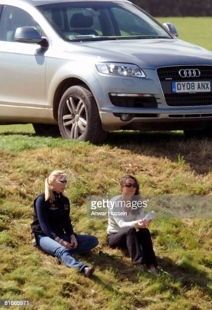 Kate Middleton relaxes with a friend as she watches Prince William take part in a charity polo match at the the Beaufort Polo Cub on June 22 2008 in...