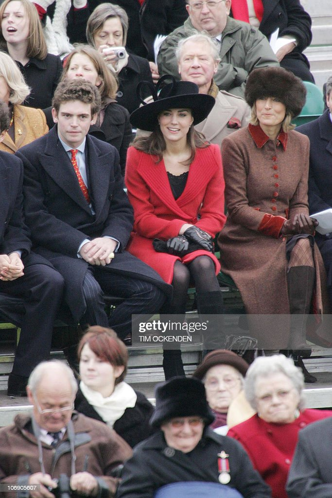 Kate Middleton, (red coat) sits in the s : News Photo