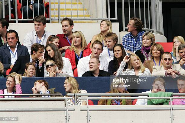 Kate Middleton talks to a guest in the Royal Box at the 'Concert for Diana' at Wembley Stadium which the Princes organised to celebrate the life of...