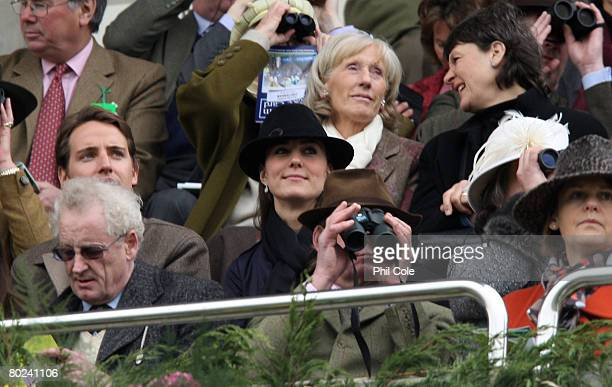 Kate Middleton watches the David Nicholson Mares Hurdle on day four of the Cheltenham festival at Cheltenham Racecourse on March 14 in Cheltenham...