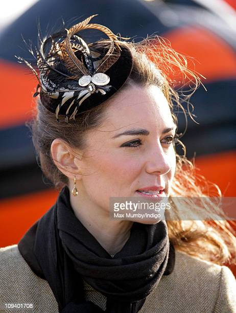 Kate Middleton wears a fascinator hat emblazoned with a 'Royal Welsh Fusiliers' Prince of Wales fleurdelys button as she attends the Naming Ceremony...