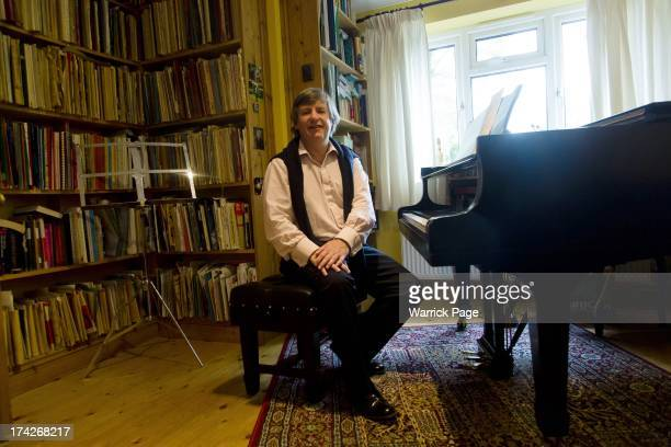 Kate Middleton's piano teacher, Daniel Nicholls, poses at his home in the Duchess of Cambridge's hometown of Bucklebury, on July 23, 2013 in...