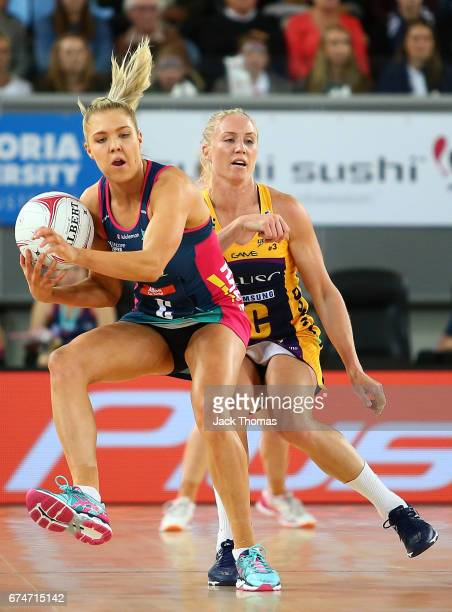 Kate Moloney of the Melbourne Vixens catches the ball during the round 10 Super Netball match between the Vixens and the Lightning at Margaret Court...