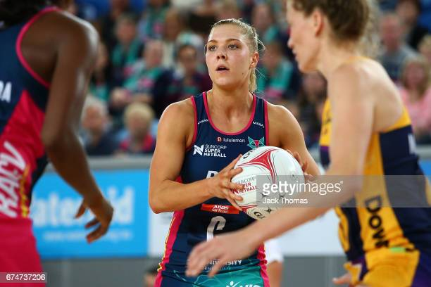 Kate Moloney of the Melbourne Vixens looks to pass during the round 10 Super Netball match between the Vixens and the Lightning at Margaret Court...