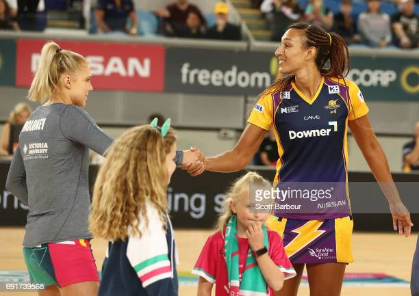 Kate Moloney of the Vixens and Geva Mentor of the Lightning shake hands during the coin toss during the Super Netball Major Semi Final match between...