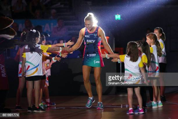 Kate Moloney of the Vixens walks onto the court during the round four Super Netball match between the Vixens and the Fever at Hisense Arena on March...