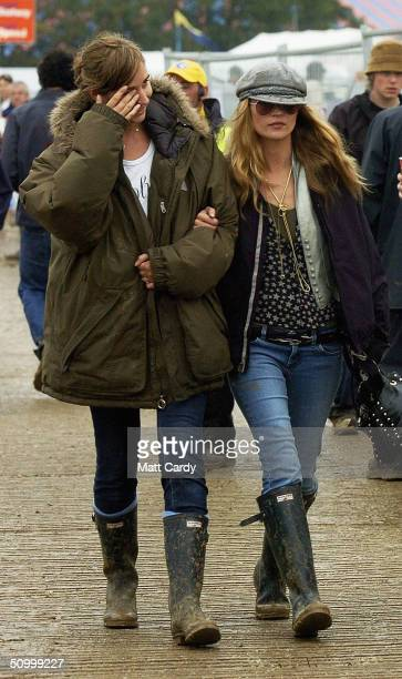 Kate Moss and a friend walk back from a bar backstage during the second day of the Glastonbury Festival 2004 at Worthy Farm Pilton on June 26 2004 in...