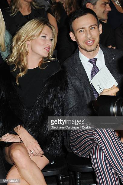 Kate Moss and Alexis Roche attend the Christian Dior show as part of Paris Fashion Week Spring/Summer 2011 in Paris