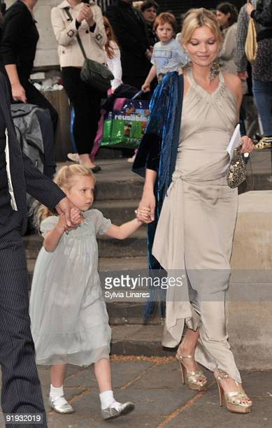 Kate Moss and her daughter attend Leah Wood and Jack Macdonald's wedding at Southwark Cathedral on June 21 2008 in London England