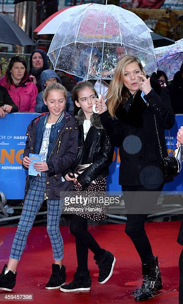 Kate Moss and her daughter Lila Grace attend the World Premiere of 'Paddington' at Odeon Leicester Square on November 23 2014 in London England