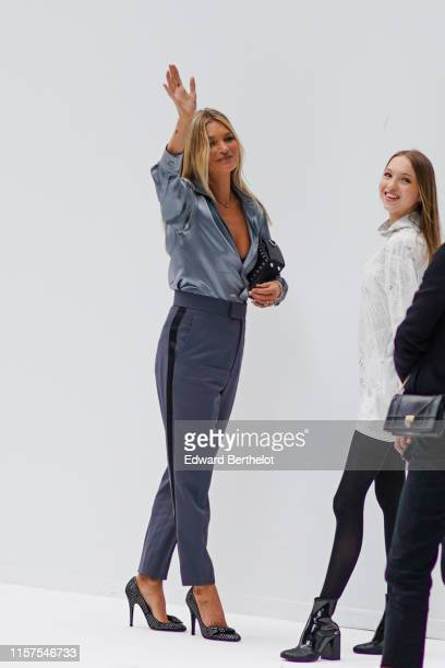 Kate Moss and her daughter Lila Grace Moss are seen outside Dior during Paris Fashion Week Menswear Spring/Summer 2020 on June 21 2019 in Paris France