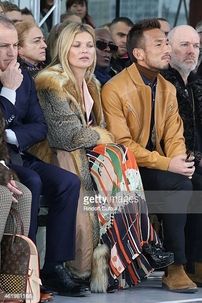 Kate Moss and Hidetoshi Nakata attend the Louis Vuitton Menswear Fall/Winter 20152016 Show as part of Paris Fashion Week on January 22 2015 in Paris...