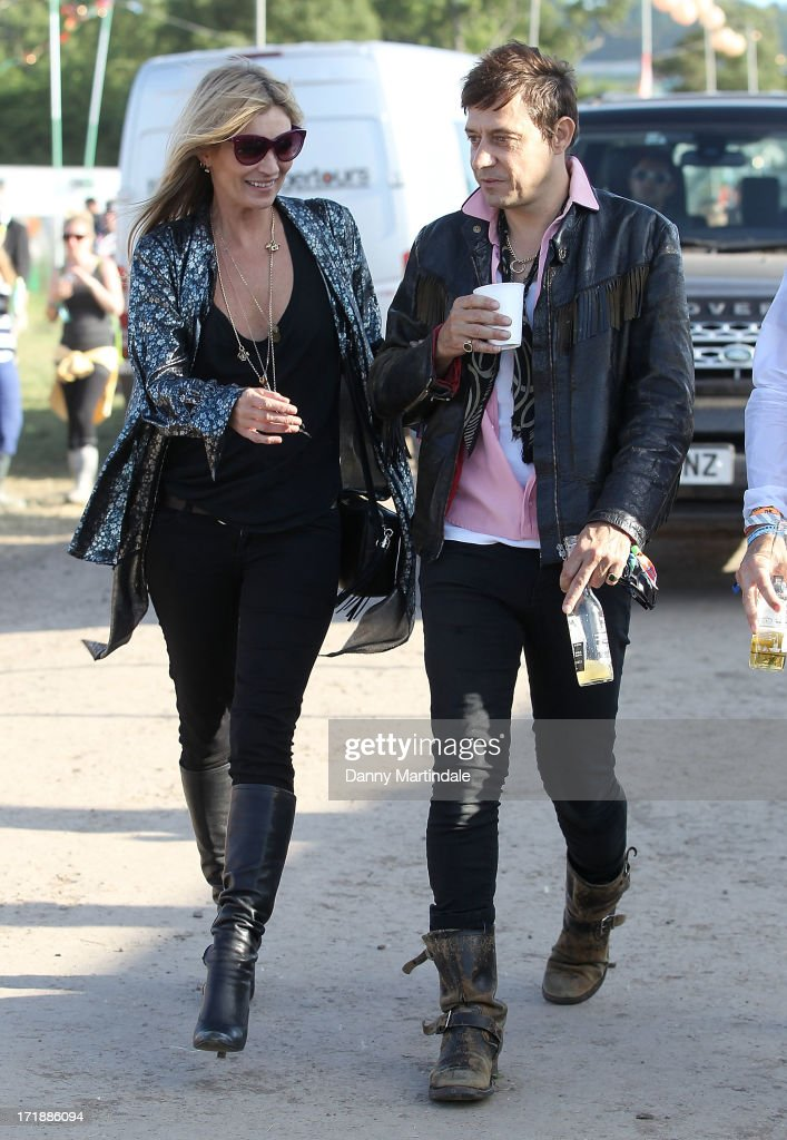 Kate Moss and Jamie Hince attend day 3 of the 2013 Glastonbury Festival at Worthy Farm on June 29, 2013 in Glastonbury, England.