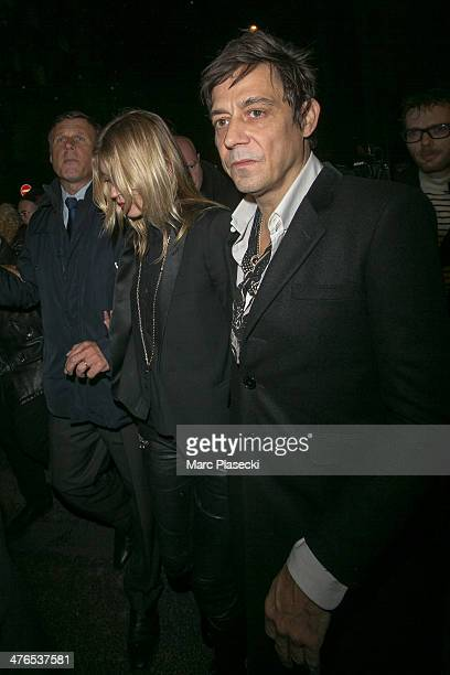 Kate Moss and Jamie Hince attend the Saint Laurent show as part of the Paris Fashion Week Womenswear Fall/Winter 20142015 on March 3 2014 in Paris...