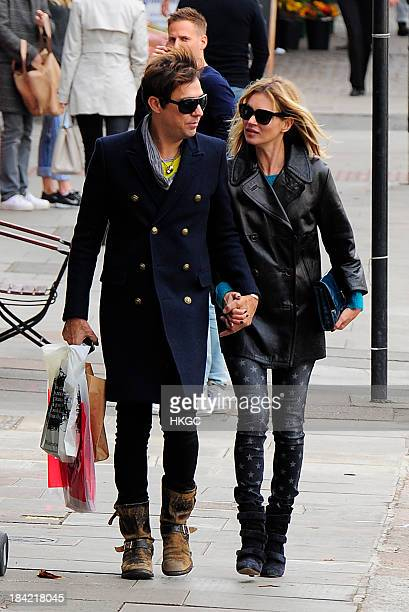 Kate Moss and Jamie Hince go shopping in North London on October 12 2013 in London England