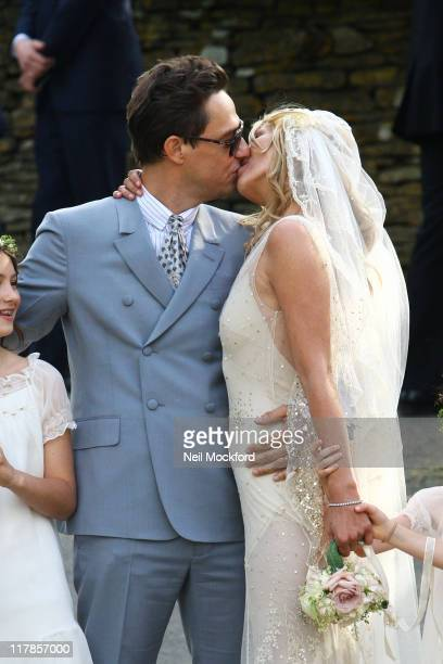 Kate Moss and Jamie Hince kiss outside the church after getting married on July 1, 2011 in Southrop, England.