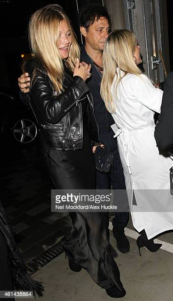 Kate Moss and Jamie Hince seen arriving at 62 Buckingham gate to attend the Maison Margiela Couture Show on January 12 2015 in London England Photo...