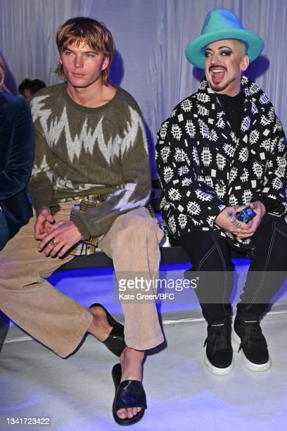Kate Moss and Jordan Barrett attend the Richard Quinn show during London Fashion Week September 2021 on September 21, 2021 in London, England.