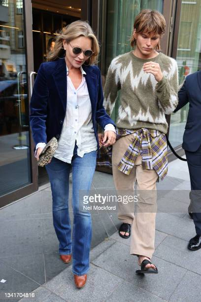 Kate Moss and Jordan Barrett leaving Richard Quinn fashion show at The Londoner Hotel during London Fashion Week September 2021 on September 21, 2021...