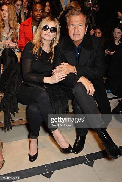 Kate Moss and Mario Testino attend the Burberry Prorsum AW 2015 show during London Fashion Week at Kensington Gardens on February 23, 2015 in London,...