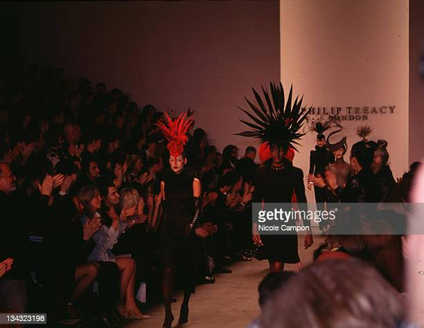 Kate Moss and Naomi Campbell during Philip Treacy Fashion Show 1997 at Bryant Park Tents in New York City New York United States
