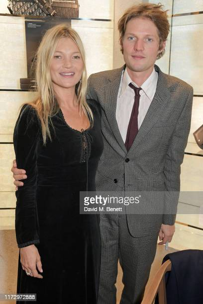 Kate Moss and Nikolai Von Bismarck attend the Dior Sessions book launch on October 01, 2019 in London, England.