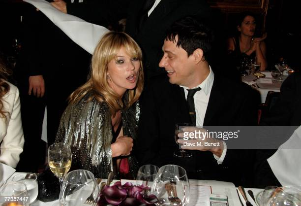 Kate Moss and partner Jamie Hince attend the launch of Kate Moss's new Top Shop 'Christmas Range' collection at Annabel's October 16, 2007 in London,...