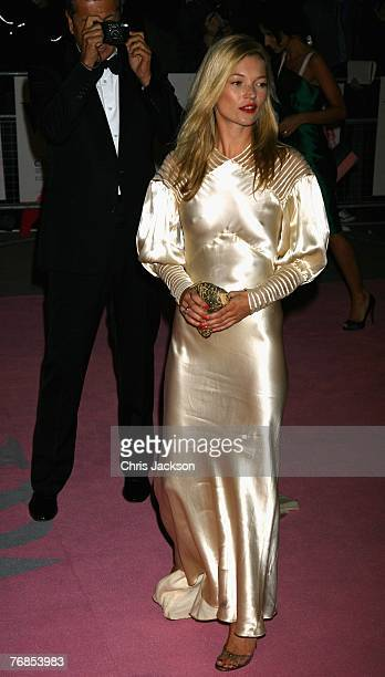 Kate Moss and photographer Mario Testino arrives at the The Golden Age Of Couture party at the Victoria Albert Museum on September 18 2007 in London...