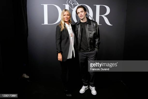 Kate Moss and Robert Pattinson attend the Dior Homme Menswear Fall/Winter 20202021 show as part of Paris Fashion Week on January 17 2020 in Paris...
