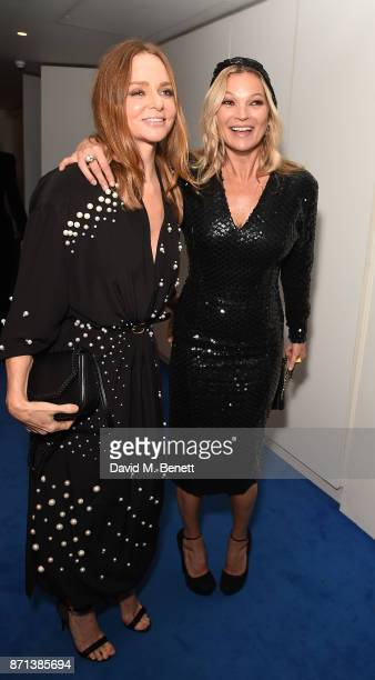 Kate Moss and Stella McCartney attends a dinner hosted by Jonathan Newhouse and Albert Read for Edward Enninful to celebrate the December issue of...