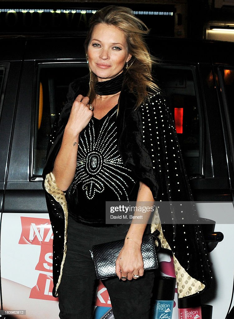Kate Moss arrives at the Rimmel London 180 Years of Cool party at the London Film Museum on October 10, 2013 in London, England.