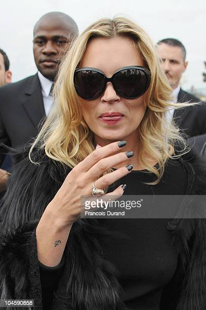Kate Moss arrives for the Christian Dior Ready to Wear Spring/Summer 2011 show during Paris Fashion Week at Espace Ephemere Tuileries on October 1...
