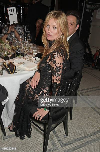 Kate Moss attends the Alexander McQueen Savage Beauty Fashion Gala at the VA presented by American Express and Kering on March 12 2015 in London...