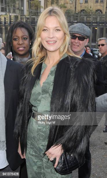 Kate Moss attends the Topshop Unique show at London Fashion Week AW14 at Tate Modern on February 16, 2014 in London, England