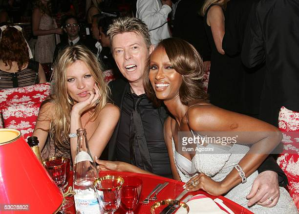 Kate Moss, David Bowie and his wife Iman pose for a photo at the 2005 CFDA Awards dinner party at the New York Public Library June 6, 2005 in New...