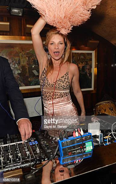 Kate Moss DJ's at the launch of Annabel's DocuFilm A String of Naked Lightbulbs at Annabel's on October 28 2014 in London England