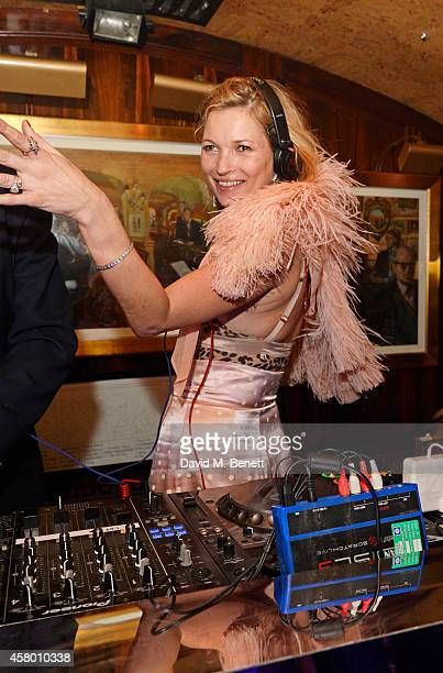 Kate Moss DJ's at the launch of Annabel's DocuFilm 'A String of Naked Lightbulbs' at Annabel's on October 28 2014 in London England