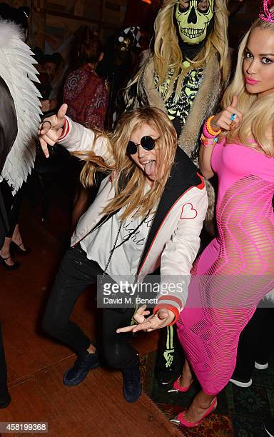 Kate Moss, dressed as Cara Delevingne, Fat Tony and Rita Ora attend 'Death Of A Geisha' hosted by Fran Cutler and Cafe KaiZen with Grey Goose on...